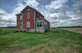 Abandoned red brick farm house near Petrolia