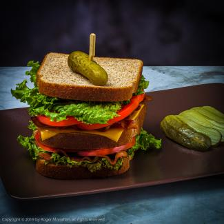 Bacon, Lettuce, Tomatoe and Cheese Sandwich with sliced pickle