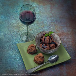 Chocolate Peanut Butter Truffles with Chocolate Ice Cream served with red wine